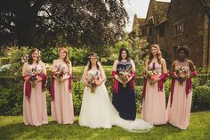 Bridesmaids wear pink and navy gowns. Photography by http://www.mattpenberthy.com/