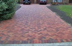 Driveway brick can be a great choice for your project while adding value to your home. See beautiful photos of brick driveway designs here. Brick Driveway, Driveway Design, Driveway Landscaping, Driveway Tiles, Brick Pathway, Stone Walkway, Brick Pavers, Landscaping Ideas, Outdoor Patio Pavers