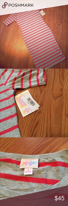 LuLaRoe gray and pink Julia dress This soft and stretchy Julia dress can be dressed up or down. The material softly hugs your curves and extends all the way down to the knee. Heathered gray with medium pink stripes. The last photo shows the true colors best. Size small which would fit a size 4-6 best. 💖 NWT. Make an offer or add to a bundle for 20% off! LuLaRoe Dresses Midi