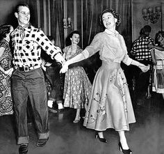 The Queen and Prince Philip dancing at a fancy dress in Ottawa in 1951.  It looks like a square dance.