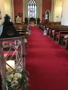 Lanterns and baby's breath posies down the aisle