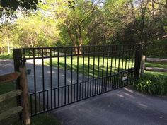 Athena single swing drive gate with dog pickets. Customer saved $10,000 by doing a self installation