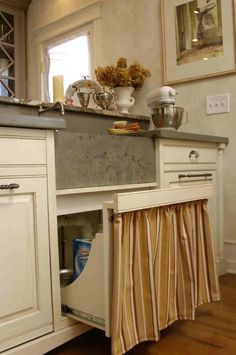 Perfect way to combine the charm of a curtain under the sink with a practical drawer