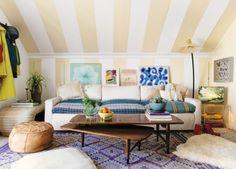 """How to create the new bohemian look at home: An example of Blakeney's 'Folksy Bohemian' this home features sloped ceilings that create nooks and niches. """"Ottomans, sheepskins and floor pillows invite guests to kick off their shoes and relax on the floor."""""""