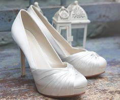 Simone - A fabulous contemporary platform wedding shoe with a lavish twisted satin overlay and sky high heels makes this beautiful court shape wedding shoe what Rainbow Club is famous for. This style fits tightly, but it makes it very secure. Dyeable Wedding Shoes, Wedding Shoes Heels, Bride Shoes, Club Shoes, Cream Shoes, White Heels, Boys Shoes, Ladies Shoes, Beautiful Shoes