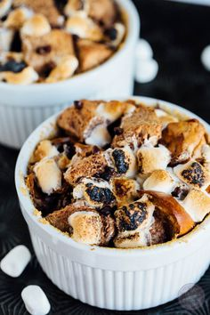 This s'mores bread pudding for two made in the oven is a great way to have an indoor campfire date night! No campfire required but a sweet tooth is a must!
