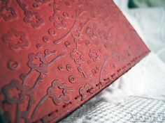 embossing to look like leather using crayon- You would not believe all of the awesome projects on this site!!