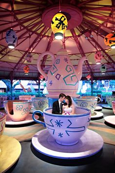 Bride and groom on the teacups at Magic Kingdom Park