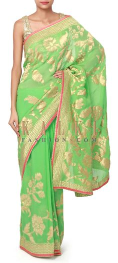 Buy Online from the link below. We ship worldwide (Free Shipping over US$100). Product SKU - 300328. Product Price - $149.00. Product Link - http://www.kalkifashion.com/green-saree-adorn-in-weave-embroidery-only-on-kalki.html