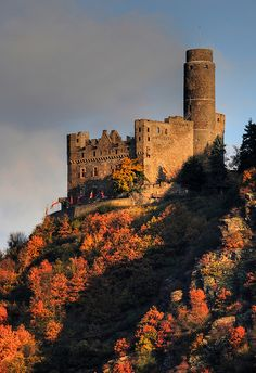 Travel along the Rhine River in Germany seeing the many castles.