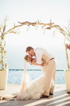 #kiss  Photography: Sara & Rocky Photography - saraandrocky.com  Read More: http://www.stylemepretty.com/destination-weddings/2014/11/12/tropical-cabo-san-lucas-beach-wedding/