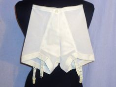 Panty girdles.  Mine had a blue ballerina in the central panel.  My first close encounter?  Junior high dance.