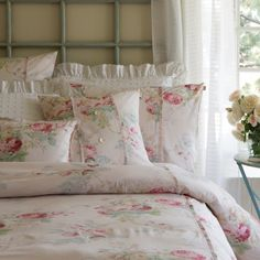 Charming cabbage roses are scattered over a soft petal background on ourexceptionally soft Shore Rose duvets and shams. 100% cotton. Machinewash cold, gentle cycle. Tumble dry low. 68