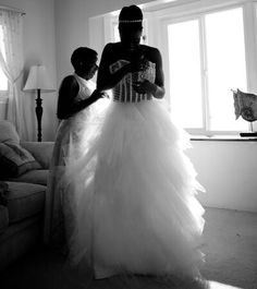 Trinity McCray getting dressed for her wedding to Jonathan Fatu.