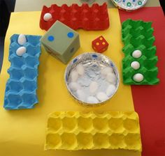 Math with colored egg cartons and cotton balls. The cubes are made of foam and stickers. This is great for a continuation project.