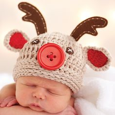 Crochet reindeer hat features felt antlers and oversized button nose. Perfect…