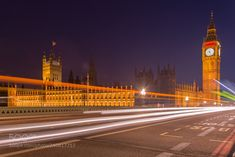 Big Ben and British Parliament over Westminster Bridge by sunj99