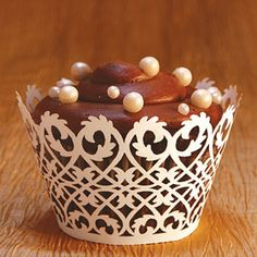 @Emily Santopetro...I am thinking more along the lines of wedding cupcakes rather than a traditional cake, since we are not having a traditional reception and I kind of like something like this. Except not chocolate.