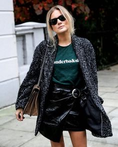 Fall outfit idea: Tweed coat, graphic T-shirt and patent leather wrap skirt.