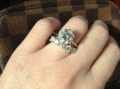 SandyCheeks-5 stone 1.6 ct, N/O color stones size 4.5, paired with a 3.0 GIA N color solitaire.