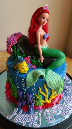 The Little Mermaid Cake And Cupcakes Made for a little girl's 6th birthday; cupcakes were frosted with buttercream and decorated with...