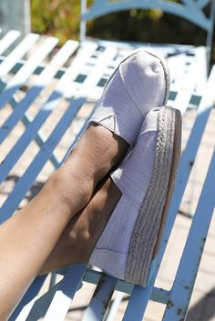 Part statement piece, part simple staple. TOMS canvas slip-on espadrilles with a rope wrapped platform and blanket stitch detail rise a little above the rest — one and a half inches to be exact.
