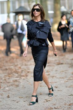 If there's anyone who knows how to rock a sexy pencil skirt, it's Carine Roitfeld, seen here in all black …