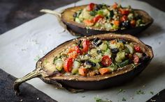 The halved eggplants in this recipe are roasted in the oven until brown and the stuffed with a mixture of lightly seasoned quinoa, sautéed mushrooms, and other vegetables.