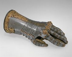 Gauntlet for the left hand                                             Gilt copper ornament attributed to Jörg Sigman              (German, Augsburg, ca. 1527–1601)                                                                                                                  Date:                                        ca. 1557