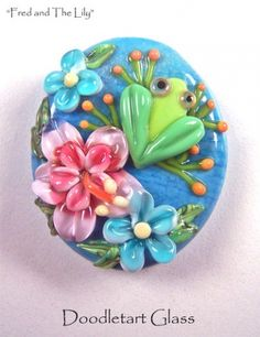 """Fred on The Lily""  Focal bead approx. 1 1/2 by 1 1/4"" 3/32 bead hole  Reference: 12967 Doodletart Glass"
