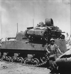 An American M4A2 Sherman carrying a Japanese Type 94 light tank on its back in Namur (1944)