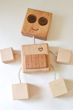 DIY Wooden Robot Buddy: If you want to make a simple wooden toy with a minimum of tools or are looking for the first woodworking lesson for older kids, try this homemade robot!