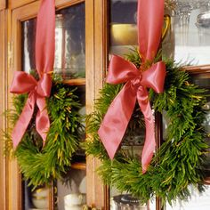 Tying a wreath to the top of the tall curio using a 3M hooks at the top is beautiful and festive.