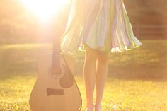 a girl and her guitar... one day i'll learn to play