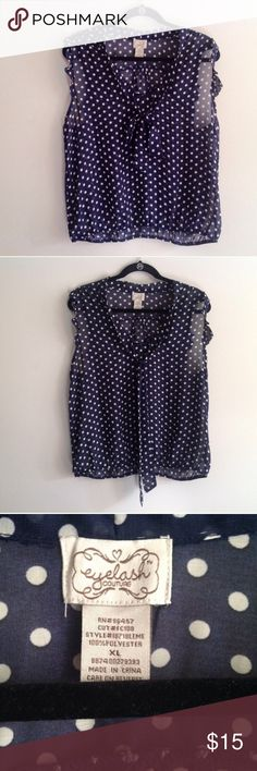"Navy blue XL sheer polka dot top Eyelash Couture navy blue sheer blouse with white Polk-a-dots. Ties in the front, size XL. A good material to keep you cool and look super cute during the summer. Or layer it under a blazer for a day at work.    Material: 100% polyester Condition: like new   Measurements (approximately): Bust: 20"" Length (shoulder to hem): 23.5""  🎀 No trades 🎀 No holds 🎀No modeling 🎀 Bundle to save! Tops Tank Tops"