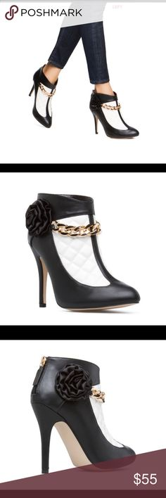 ❣️❣️ankle bootie❣️❣️ This black /white color blocked bootie,a floral accent and front draping chain-link is gorgeous 👌👌💖💖 Shoes Ankle Boots & Booties
