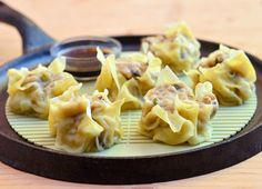 Siomai...steamed dumplings made with chicken, shrimp, Napa cabbage, shitake mushrooms and green onions