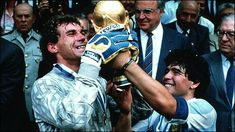 Argentina goalkeeper Nery Pumpido and captain Diego Maradona lift the World Cup 1986