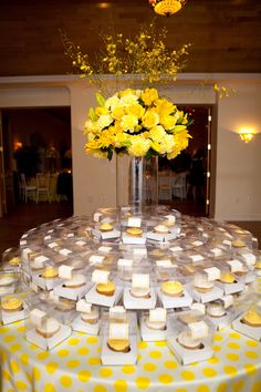 Yellow Round Arrangment. Yellow Football mums. Asiatic Lilies, billy balls, roses, carnations and yellow tulips. orchids coming out the top.