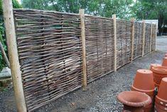 Belgian hazelwood fencing panels - drop posts 4 feet below grade to secure fence. Garden Privacy, Garden Fencing, Garden Beds, Garden Landscaping, Garden Trellis, Deco Spa, Wattle Fence, Garden Works, Natural Garden