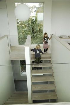 love the open stairs, wood color, use of wall between the stairs instead of railings...glass on part, light fixture