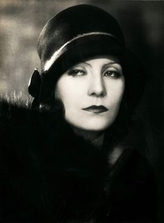 Greta Garbo, smouldering in a publicity photo from 1930, the year she moved from silent movies into talkies. Her first talking movie was advertised to the slogan 'Garbo Talks!' Ha ha! Give that publicity man a cigar…