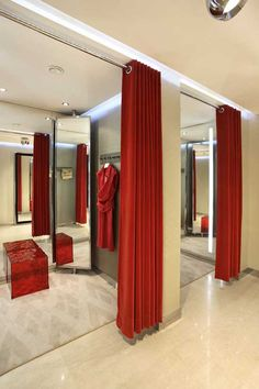 I love these fitting rooms. The large mirrors and repetition of bright red is very eye catching. I also love the use of thick curtains for privacy in the fitting rooms.