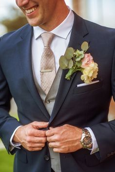 groom in navy grey and champagne suit and tie