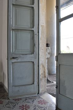 grey---and wonderful old tile floor and door....makes me think of a Ugandan Hospital