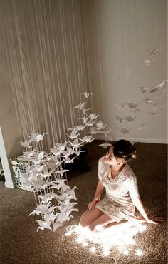What a beautiful installation of origami cranes for a serene and ...
