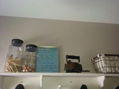 Laundry room shelf and jars from good will painted and cleaned up. Sign made on computer in dollar store frame. I copied one similar in Ballard design catalog. Iron from antique store