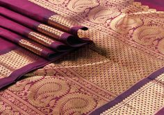 """The #classicarakku 9 yards Saree with a rich """"arai madam"""" border in the border. The pallu is #grand and lustrous with #pure zari - a combination of the #traditional #mango and half #diamond design! Breath taking."""