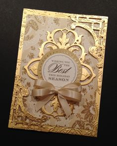 Gold Wishing you the Best Holiday Season ever using gold foil, die cuts, ribbon bow, printed sentiment, almost over the top - card