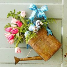 easter decorating round up, easter decorations, fireplaces mantels, patriotic decor ideas, seasonal holiday d cor, wreaths, I LOVE this Spring or Easter Watering Can Wreath from Better Homes Gardens